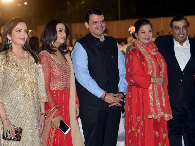 Maharashtra chief minister, Devendra Fadnavis along with his wife Amrita, Bollywood actor Shabana Azmi and industrialist Mukesh Ambani and wife Neeta at MAMI. (PTI)