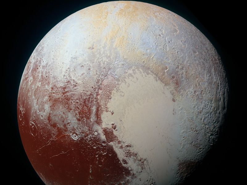 Pluto Dazzles in False Color: New Horizons scientists use enhanced color images to detect differences in the composition and texture of Pluto's surface.  (NASA)