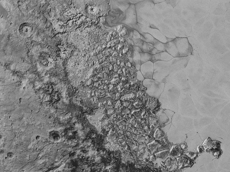 Sputnik Planum: In the center of this 300-mile (470-kilometer) wide image of Pluto from NASA's New Horizons spacecraft is a large region of jumbled, broken terrain on the northwestern edge of the vast, icy plain informally called Sputnik Planum, to the right.  (NASA)