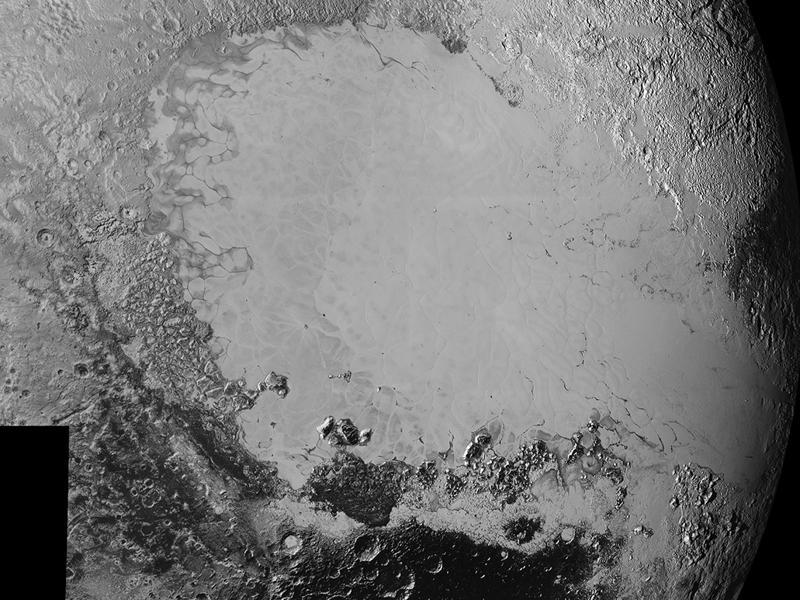 Mosaic of high-resolution images of Pluto, sent back from NASA's New Horizons spacecraft from Sept. 5 to 7, 2015. The image is dominated by the informally-named icy plain Sputnik Planum, the smooth, bright region across the center.  (NASA)