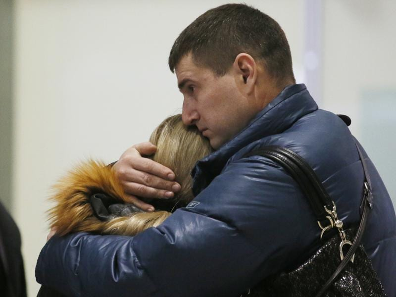 Relatives react after a Russian airliner with 217 passengers and seven crew aboard crashed, as people gather at Russian airline Kogalymavia's information desk at Pulkovo airport in St.Petersburg, Russia. (AP Photo)