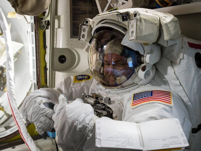 Expedition 45 Commander Scott Kelly tries on his spacesuit for a fit check inside the U. Quest airlock of the International Space Station. (Photo courtesy: nasa.gov)