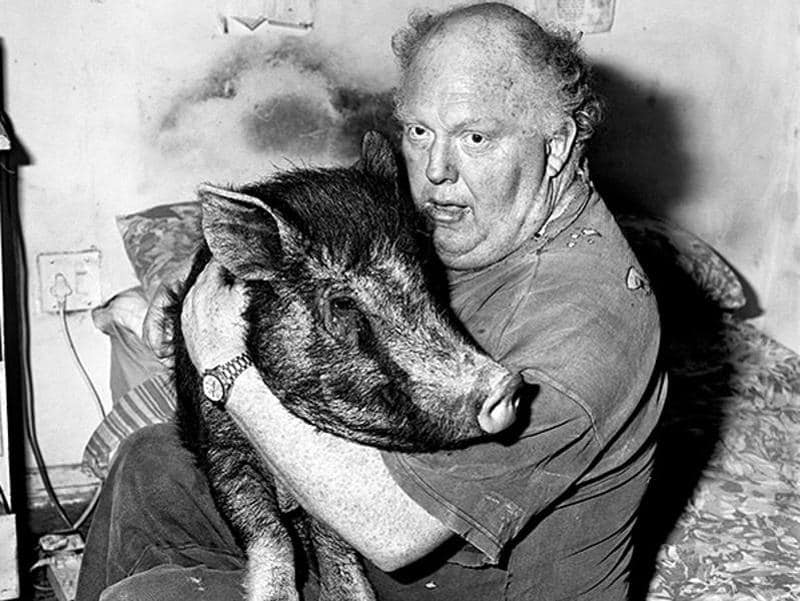 'Brian With Pig' (1998), a photo by Roger Ballen from his series, Outland. (Roger Ballen and PHOTOINK)