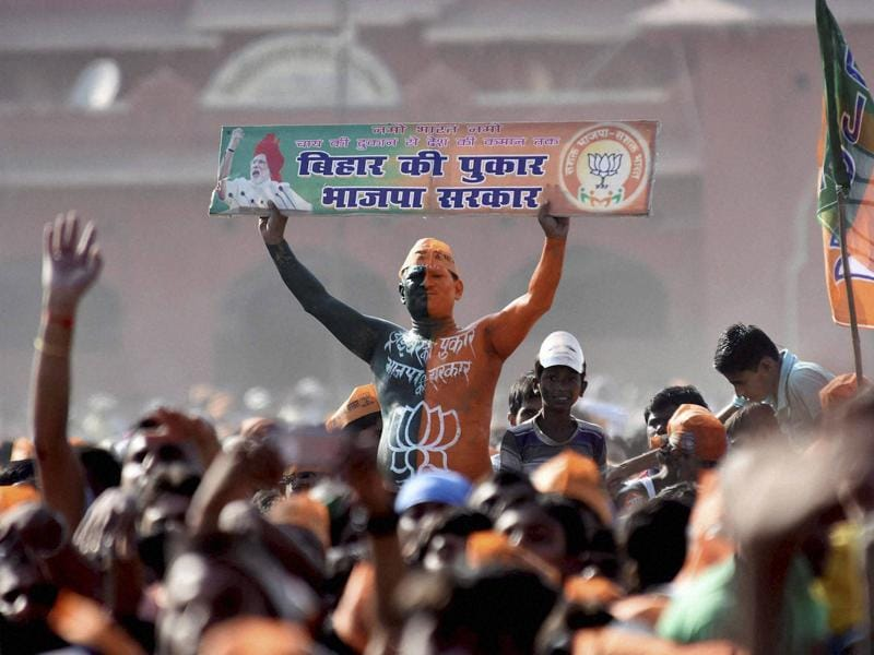 A BJP supporter during an election rally in Darbhanga on Monday. (PTI)