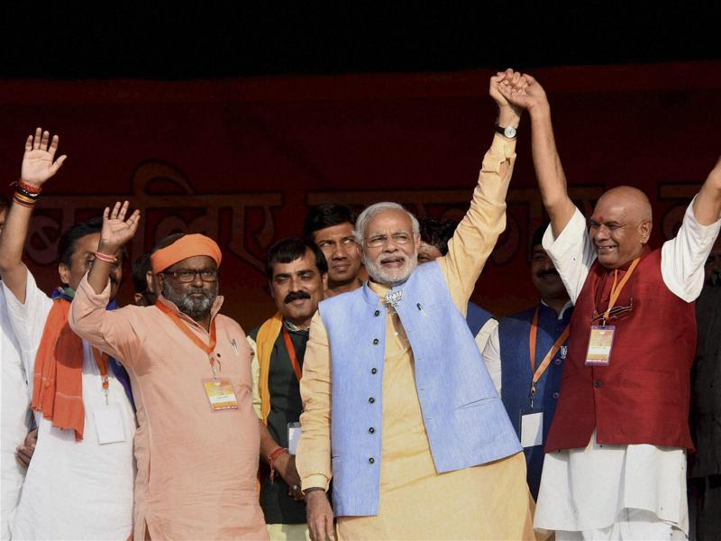 Prime Minister Narendra Modi with other NDA leaders during an election rally in Darbhanga on Monday.  (PTI)