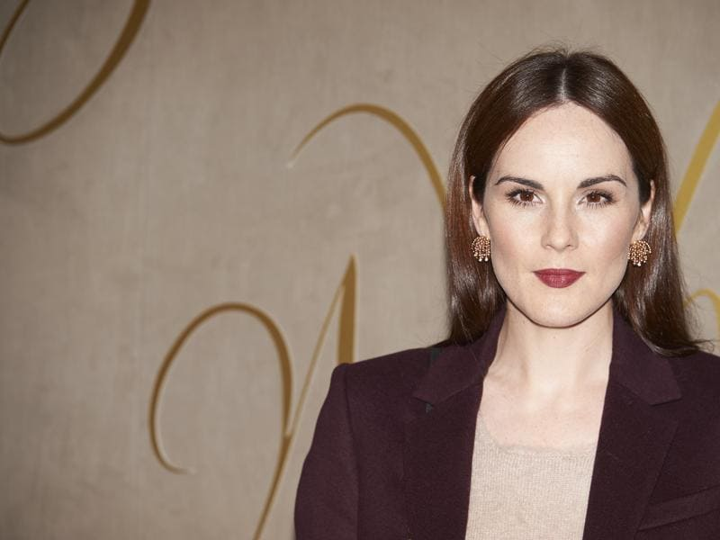 British actor Michelle Dockery, famous for Downton Abbey arrives at the premiere of the Burberry festive film. (AFP)