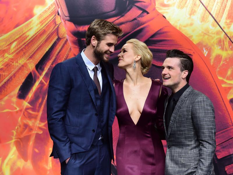 Liam Hemsworth,  Jennifer Lawrence and Josh Hutcherson pose for photographers on the red carpet as they arrive for the world premiere of the movie The Hunger Games: Mockingjay — Part 2, in Berlin. (AFP)