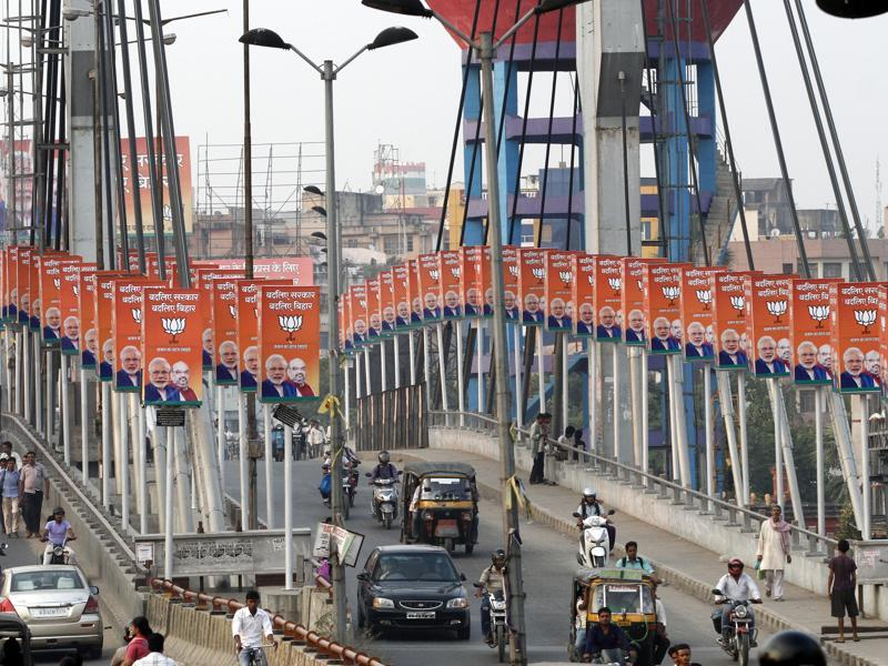 Patna's Chiraiya Tand bridge is flanked by saffron-hued posters of Prime Minister Narendra Modi and BJP president Amit Shah on both sides, ahead of the hotly-contested Bihar elections. (Arvind Yadav/ HT Photo)