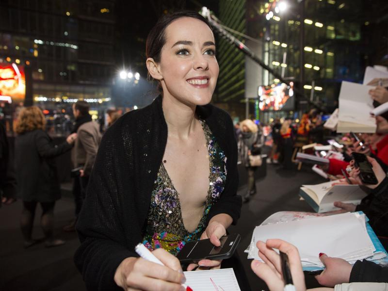 Jena Malone signs autographs before the world premiere of The Hunger Games: Mockingjay - Part 2. (AP)