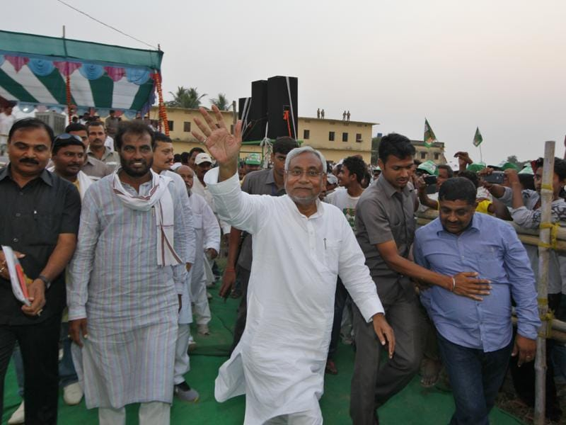 Bihar chief minister Nitish Kumar waves to cameras during an election rally at Phulwari Sharif in Patna. The election is a litmus test for Nitish Kumar who faces anti-incumbency and needs to prove a point to friend-turned-foe BJP.  (Arvind yadav/ HT Photo)