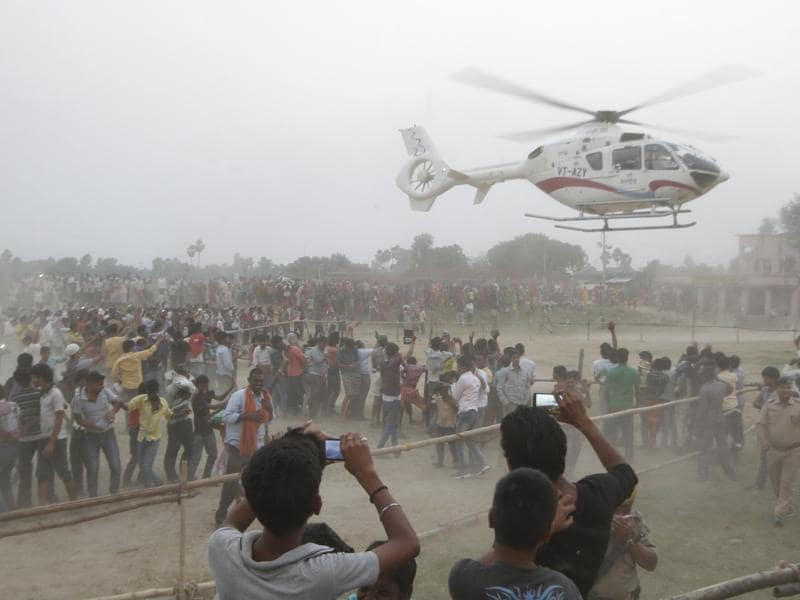 Bihar chief minister Nitish Kumar takes off in his helicopter after a rally at Phulwari Sharif in Patna, India. Helicopters have been the preferred mode of transport for top leaders in the Bihar elections, also acting as crowd pullers. (Arvind yadav/ HT Photo)