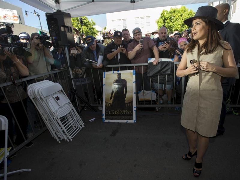 Salma Hayek poses at the unveiling of the star for director Ridley Scott on the Hollywood Walk of Fame. (REUTERS)
