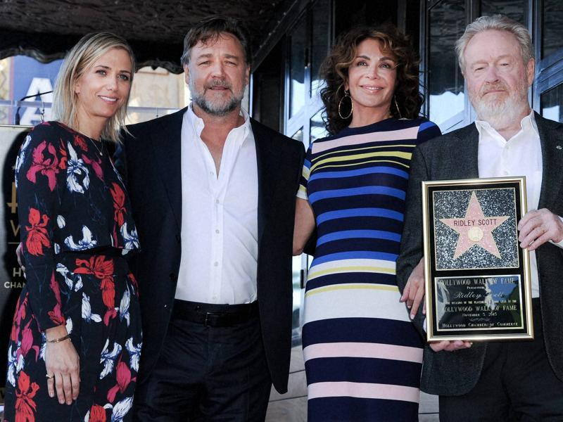 Actor Kristen Wiig, Russell Crowe, Giannina Facio and director Ridley Scott attend a ceremony honouring Scott with a star on the Hollywood Walk of Fame. (AP)