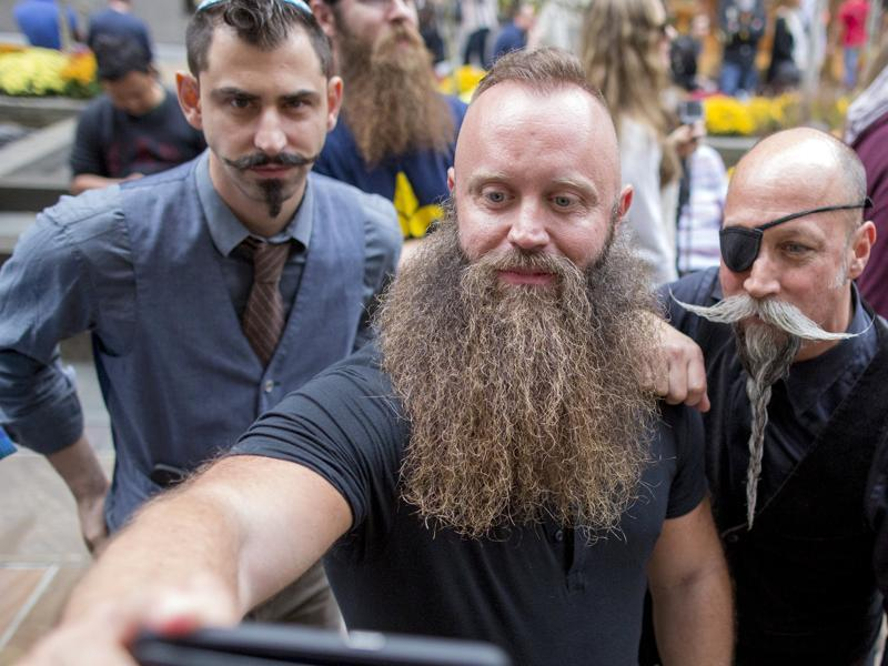 Contestants pose together for a selfie as they gather to promote the National Beard and Moustache Championships in New York, November 6, 2015.  (REUTERS)