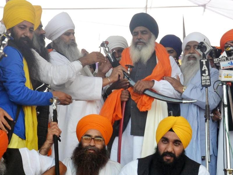 Newly-appointed acting Akal Takht jathedar Dhain Singh Mand being honoured radicals during the Sarbat Khalsa on Tuesday.  (Sameer Sehgal/HT)