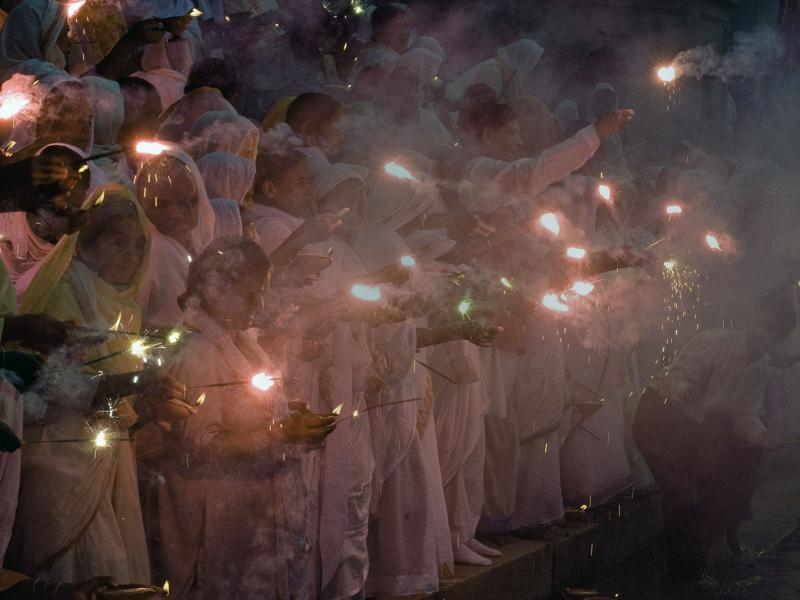 Widows hold sparklers and deepas -- oil lamps -- during Diwali celebrations at Kesi Ghat on the banks of the Yamuna river in Vrindavan . (AFP)