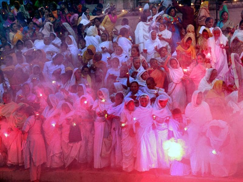 Bengali widows celebrating Diwali festival at Vrindavan in Uttar Pradesh on Tuesday.  (PTI)