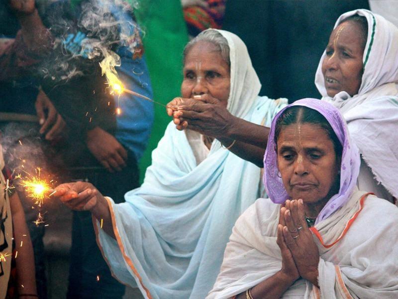 Widows of Vrindavan celebrate Diwali organised by Sulabh International at Vrindavan in Uttar Pradesh on Tuesday. (PTI)