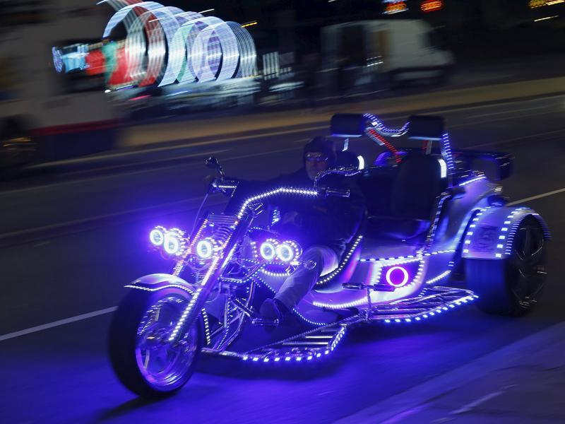 A man rides an illuminated trike during Diwali celebrations in Leicester, Britain November 11, 2015.  (REUTERS)