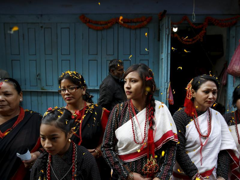 Participants from Newar community in traditional attire, takes part in the parade to celebrate Newari New Year that falls during the Tihar festival, also called Diwali, in Kathmandu, Nepal November 12, 2015. The Newar community observes the start of their Newari New Year 1136, in accordance with their lunar calendar, by worshipping their spiritual selves in a ritual known as