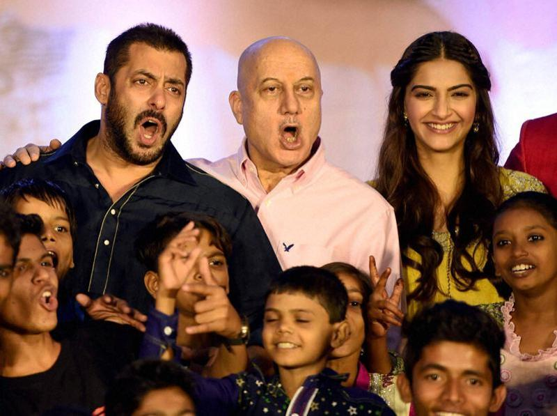 Salman Khan, Sonam Kapoor and Anupam Kher along with Dharavi Rocks,  a band of kids who make music out of waste materials during a promotional event for Prem Ratan Dhan Payo in Mumbai on Wednesday.  (PTI)