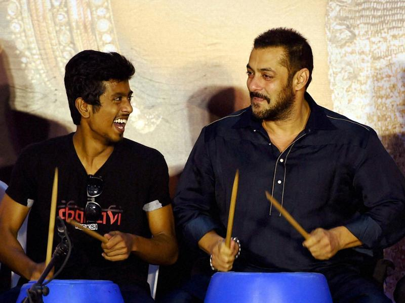 Salman Khan along with 'Dharavi Rocks' -  a band of kids who make music out of waste materials  -in Mumbai on Wednesday.  (PTI)