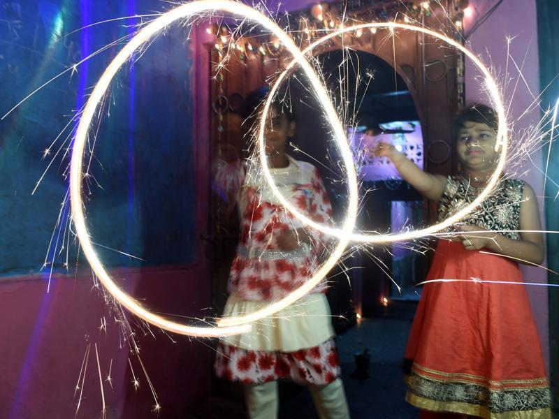 Hindus celebrate Diwali  with fireworks in Karachi , Pakistan.  Prime Minister Nawaz Sharif  vowed to take action against injustice towards Hindus in Pakistan, saying he will stand with them against the oppressor as he is the premier of all communities. (AFP)