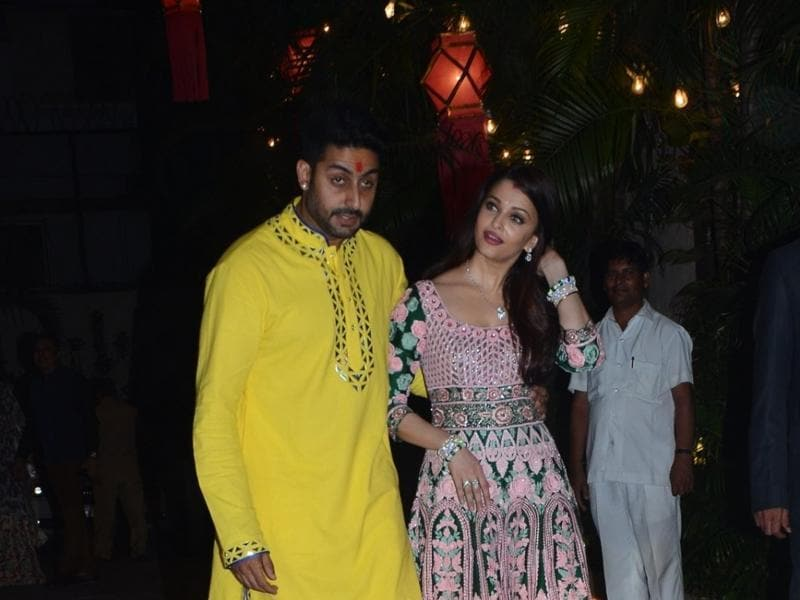 Aishwarya Rai Bachchan and Abhishek Bachchan welcome guests at Amitabh Bachchan`s Diwali party in Mumbai on Nov 11, 2015.  (IANS)