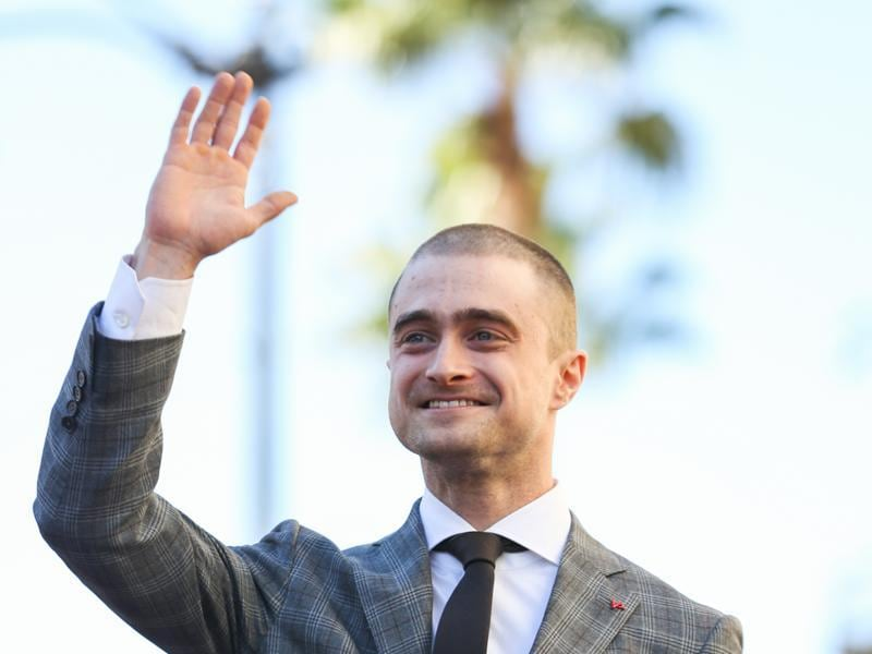 Daniel Radcliffe waves to his fans as he receives a star on the Hollywood Walk of Fame. (AP)