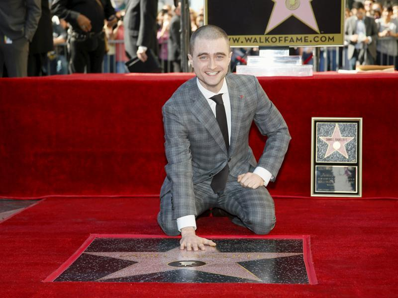 Actor Daniel Radcliffe poses during a ceremony honouring him with a star on the Hollywood Walk of Fame in Hollywood, California. (REUTERS)