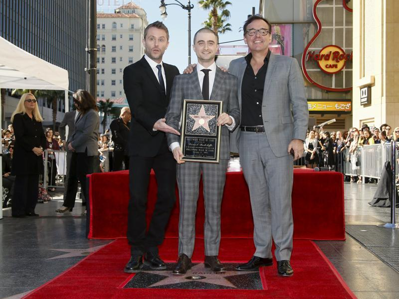Harry Potter star Daniel Radcliffe poses along with actor Chris Hardwick  and filmmaker Chris Columbus (director of the first two Harry Potter movies) in Hollywood, California. (REUTERS)