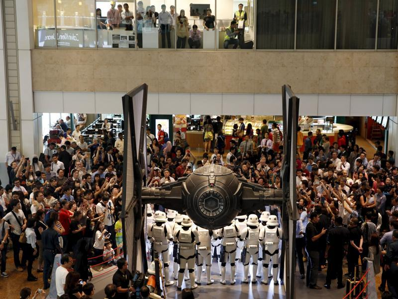People take photos of Stormtroopers as they gather around a life-sized Star Wars TIE Fighter model on display at Singapore's Changi Airport. (REUTERS)
