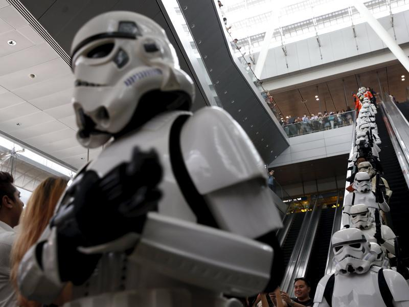 Stormtroopers take the escalator as they march around Singapore's Changi Airport. (REUTERS)