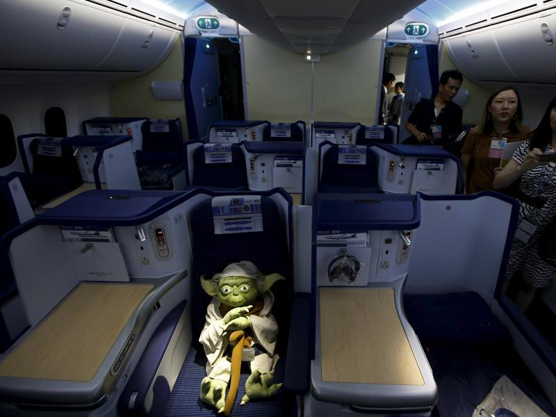 Visitors look at a Yoda plush toy sitting in the business class section during a tour of the Star Wars-themed All Nippon Airways ANA R2-D2 Boeing 787 Dreamliner aircraft in Singapore's Changi Airport. (REUTERS)