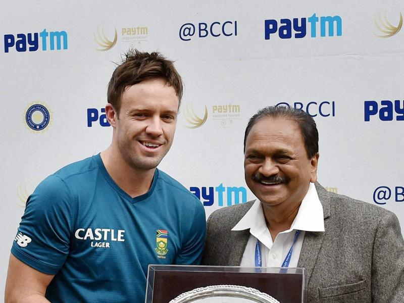 Before the start of the match, AB de Villiers is felicitated by BCCI Vice President G Gangaraju on the occasion of his 100th Test. (PTI Photo)
