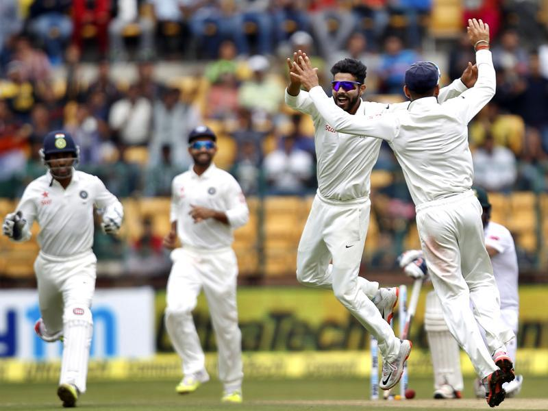 India's Ravindra Jadeja and captain Virat Kohli celebrate the dismissal of South Africa's Dean Elgar on the first day of the second Test at the M Chinnaswamy Stadium in Bengaluru on November 14, 2015. (Ajay Aggarwal/HT Photo)