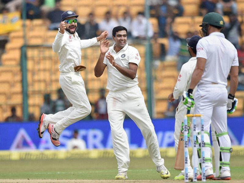India's Ravichandran Ashwin and Virat Kohli celebrates the wicket of South Africa's Faf Du Plessis. (PTI Photo)