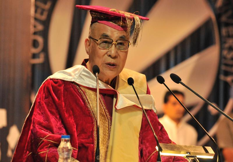 Tibetan spiritual leader the 14th Dalai Lama addressing the students during the convocation at Lovely Professional University near Jalandhar. (HT Photo )
