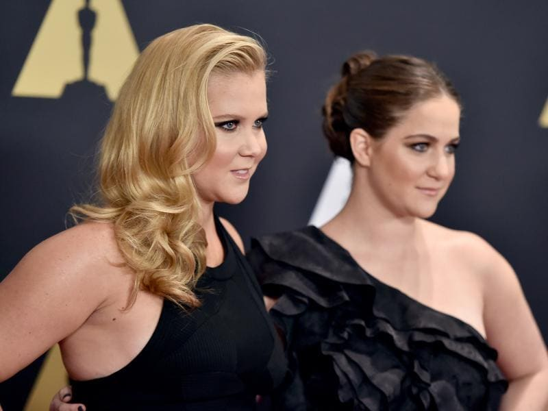 Amy Schumer from the movie Trainwreck and Kim Caramele arrive at the Governors Awards. (AP)
