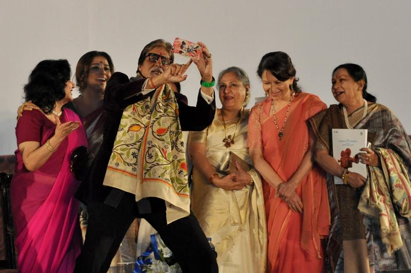 Height seems to be an impediment as Amitabh Bachchan tries to capture the Bengal tigresses. (IANS)