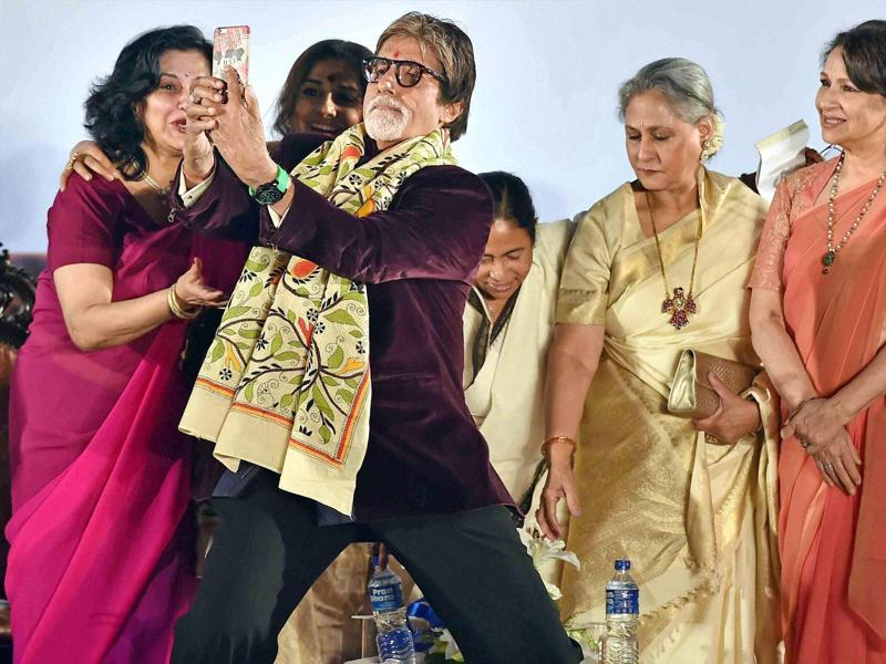 Actor Amitabh Bachchan is busy taking the selfie as West Bengal Chief Minister Mamata Banerjee, Jaya Bachchan, Sharmila Tagore, Vidya Balan and Moushumi Chatterjee look on. (PTI)