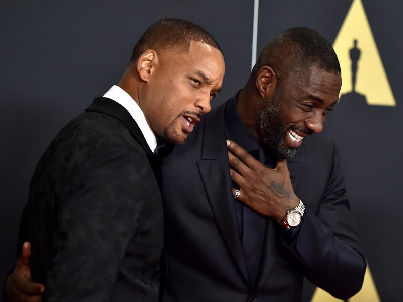 Will Smith and Idris Elba share a light moment at the Governors Awards red carpet in LA. (AP)