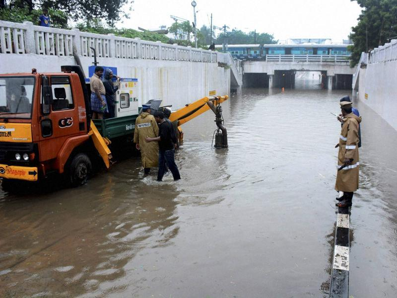 Corporation workers pumping out the rainwater from a waterlogged subway following heavy rains in Chennai. (PTI)