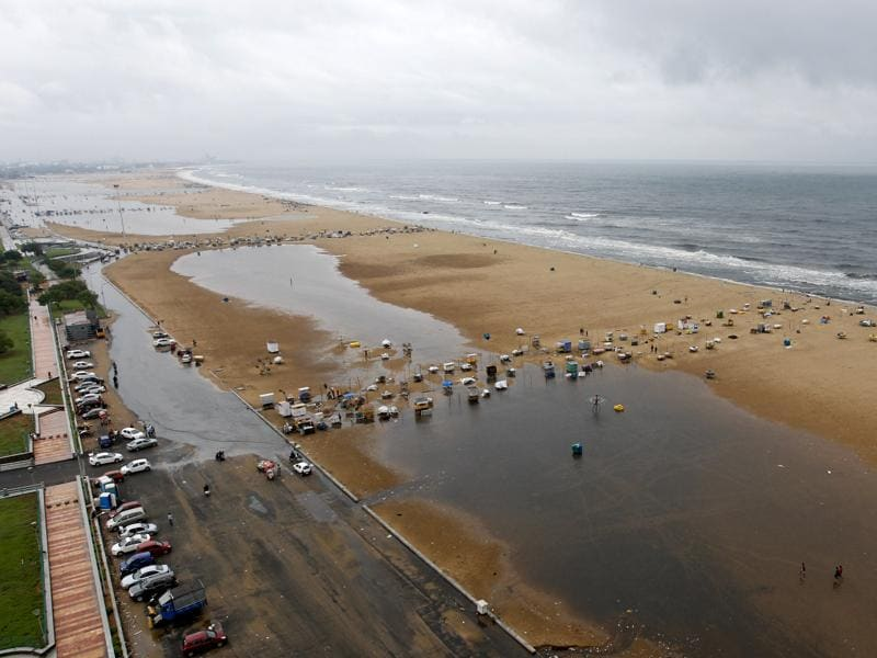 The Marina beach on the Bay of Bengal coast is partly covered with rainwater after heavy rains in Chennai (AP)