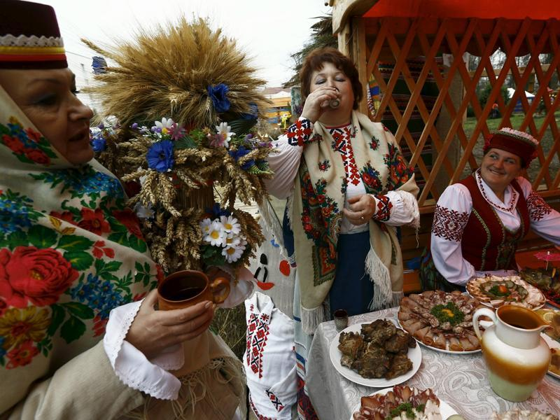 Women dressed in national clothes drink during the harvest festival in Dyatlovo, Belarus. (REUTERS)