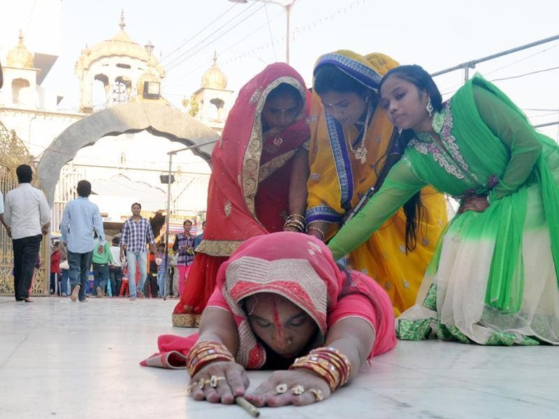 Devotees offering prayers at the Durgiana temple in Amritsar on Tuesday.  (Sameer Sehgal/HT Photo)