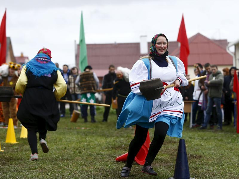 People play during the harvest festival in Dyatlovo, Belarus. (REUTERS)