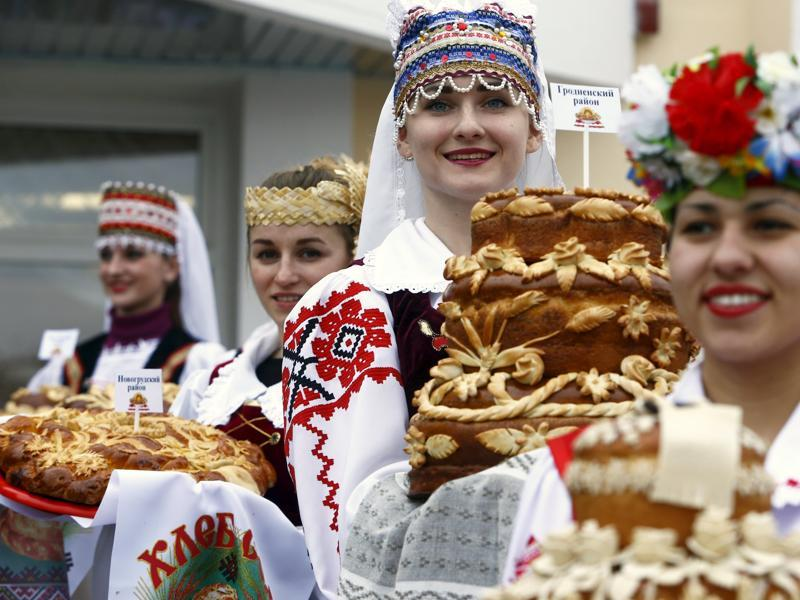 Dozhynki, the harvest festival of Belarus, marks the end of the harvesting in that nation. Women dressed in national clothes hold loaves as they wait for the participants of the regional harvest festival in the town of Dyatlovo, Belarus, November 13, 2015. (REUTERS)