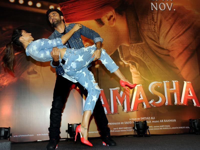 Oh, it's fun and the job's half done! Ranbir Kapoor and Deepika Padukone at the promotional event for Tamasha. (AFP)