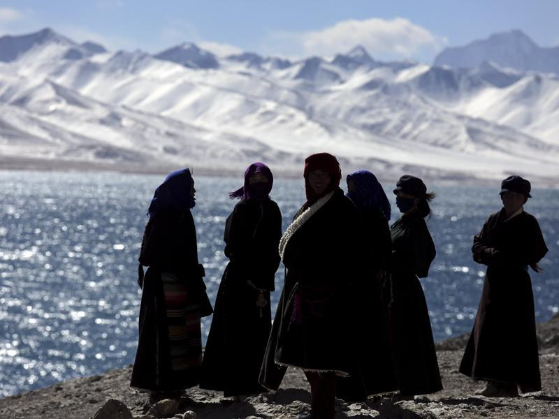 Tibetan people visit Namtso lake in the Tibet Autonomous Region, China.  (REUTERS)